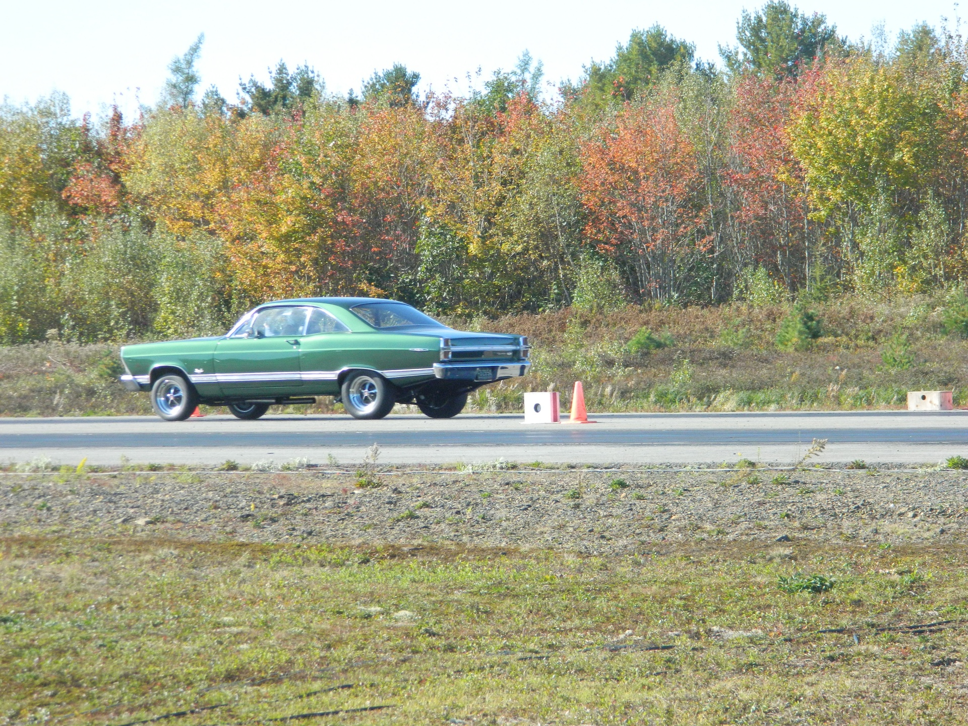 67 Fairlane making a run down the track.
